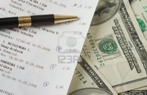 4909022-close-up-of-sports-betting-slip-and-pencil-600x400