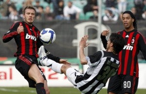Siena's Del Grosso challenges AC Milan's Beckham during their Italian Serie A soccer match in Siena