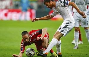Bayern Munich's Ribery is challenged by Real Madrid's Alonso during their Champions League semi-final second leg soccer match in Munich