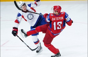 Russia's Pavel Datsyuk (R)  hits Norway'