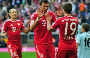 MUNICH, GERMANY - OCTOBER 19:  Mario Mandzukic  (C) celebrates with team-mates Arjen Robben (L) and Mario Goetze (R) after scoring their third goal during the Bundesliga match between FC Bayern Muenchen and 1. FSV Mainz 05 at Allianz Arena on October 19, 2013 in Munich, Germany.  (Photo by Lennart Preiss/Bongarts/Getty Images)