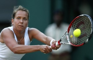 Barbora Zahlavova Strycova of the Czech Republic plays a return to Petra Kvitova of the Czech Republic during their women's quarterfinal match at the All England Lawn Tennis Championships in Wimbledon, London, Tuesday, July 1, 2014. (AP Photo/Ben Curtis)