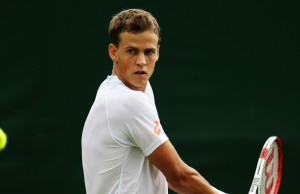 LONDON, ENGLAND - JUNE 23:  Vasek Pospisil of Canada in action during his Gentlemen's Singles first round match against Robin Haase of the Netherlands on day one of the Wimbledon Lawn Tennis Championships at the All England Lawn Tennis and Croquet Club at Wimbledon on June 23, 2014 in London, England.  (Photo by Steve Bardens/Getty Images)