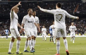 ©Ballesteros/EFE/MAXPPP- Madrid Spain 24/03/2012 ; Real Madrid's Portuguese striker Cristiano Ronaldo (R) jubilates with his team mates French Karim Benzema (L), Argentinian striker Gonzalo Higuain (2L) and German midfielder Sami Khedira (2R) his goal against Real Sociedad during their Primera Division soccer match played at Santiago Bernabeu stadium in Madrid, Spain on 24 March 2012. EFE/Ballesteros  ***************************************** FRANCE ONLY *****************************************