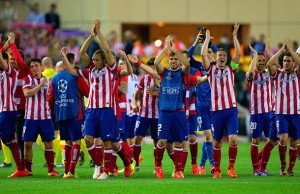 MADRID, SPAIN - APRIL 09:  Club Atletico de Madrid applaud their fans as they celebrate victory during the UEFA Champions League Quarter Final second leg match between Club Atletico de Madrid and FC Barcelona at Vicente Calderon Stadium on April 9, 2014 in Madrid, Spain.  (Photo by Gonzalo Arroyo Moreno/Getty Images)